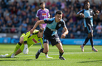 Luke O'Nien of Wycombe Wanderers chases a loose ball in the goal area during the Sky Bet League 2 match between Wycombe Wanderers and Plymouth Argyle at Adams Park, High Wycombe, England on 12 September 2015. Photo by Andy Rowland.
