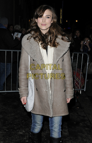 "KEIRA KNIGHTLEY.leaves after her evening performance of ""The Misanthrope"", ComedyTheatre, London, England, UK, 8th January 2010 half length brown grey gray sheepskin coat jeans bag scarf brown cream striped tote bag shopper  .CAP/CAN.©Can Nguyen/Capital Pictures"