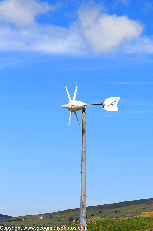 Rutland Windcharger turbine against blue sky, Snowdonia, north Wales, UK view down to Llanberis