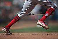 SAN FRANCISCO, CA - MAY 16:  Detail of Billy Hamilton #6 of the Cincinnati Reds wearing red socks and red Adidas cleats as he bats and runs to first base against the San Francisco Giants during the game at AT&T Park on Wednesday, May 16, 2018 in San Francisco, California. (Photo by Brad Mangin)
