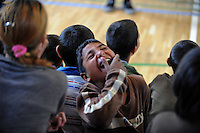 """A young child erupts with laughter while watching a performance by Roma or gypsy theater Romathan in """"Dwarf"""" at the Banske Elementary School with a Roma or gypsy majority student body in Banske, Slovakia on June 2, 2010."""