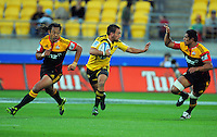 Hurricanes first five Aaron Cruden tries to run between Tana Umaga (left) and Tanerau Latimer. Super 15 rugby match - Hurricanes v Chiefs at Westpac Stadium, Wellington, New Zealand on Saturday, 12 March 2011. Photo: Dave Lintott / lintottphoto.co.nz