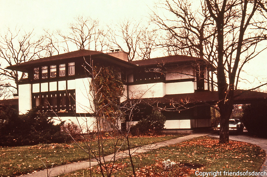 Frank Lloyd Wright: Ward W.Willits House, the first of Wright's Prairie Houses. The plan is a cruciate with four wings extending out from a central fireplace. In addition to stained-glass windows and wooden screens that divide rooms, Wright also designed most of the furniture in the house.Highland Park, IL.NRHP 1980.(Photo Feb. 1988)