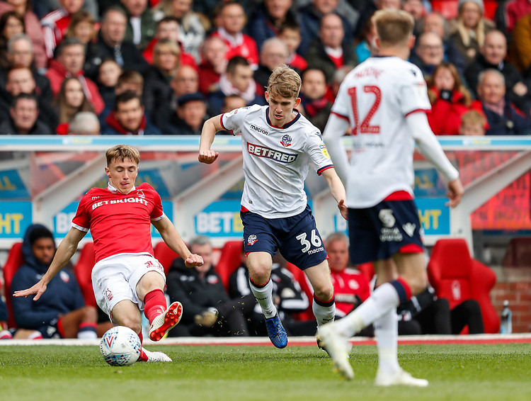 Bolton Wanderers' Harry Brockbank competing with Nottingham Forest's Ben Osborn <br /> <br /> Photographer Andrew Kearns/CameraSport<br /> <br /> The EFL Sky Bet Championship - Nottingham Forest v Bolton Wanderers - Sunday 5th May 2019 - The City Ground - Nottingham<br /> <br /> World Copyright © 2019 CameraSport. All rights reserved. 43 Linden Ave. Countesthorpe. Leicester. England. LE8 5PG - Tel: +44 (0) 116 277 4147 - admin@camerasport.com - www.camerasport.com