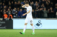 Federico Fernandez of Swansea City leaves the field after the final whistle during the Premier League match between Swansea City and Tottenham Hotspur at The Liberty Stadium, Swansea, Wales, UK. Wednesday 05 April 2017