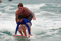 Saturday, August 23 2008.  Austin Oliver shares a surfboard with Luis Castro during the 22nd Annual Kids Day hosted by the Windansea Surf Club at La Jolla Shores.