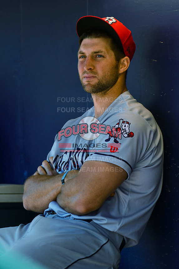 Tim Tebow (15) of the Binghamton Rumble Ponies sits in the dugout during a game against the Hartford Yard Goats at Dunkin Donuts Park on May 9, 2018 in Hartford, Connecticut. (Gregory Vasil/Four Seam Images)