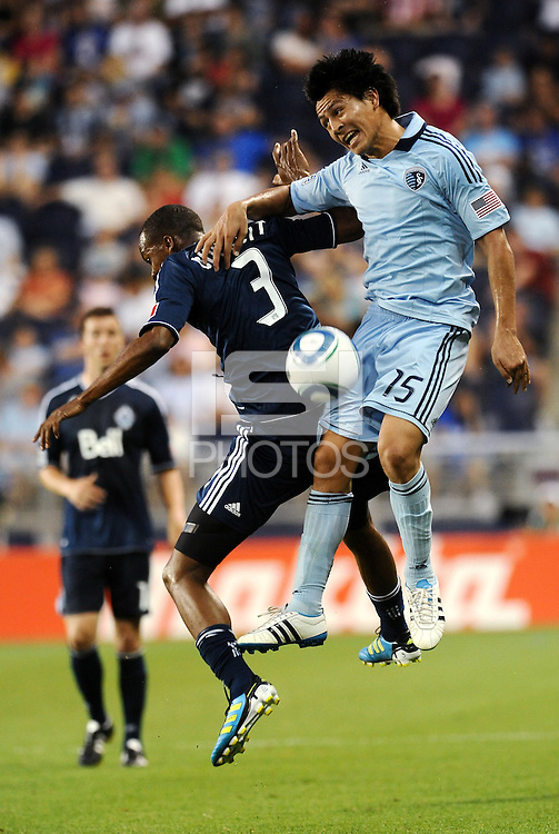 Roger Espinoza (15) Sporting KC and Bilal Duckett Vancouver Whitecaps challenge for a header... Sporting KC defeated Vancouver Whitecaps 2-1 at LIVESTRONG Sporting Park, Kansas City, Kansas.