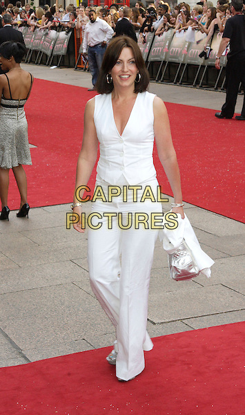 "DAVINA McCALL.World Premiere of ""Sex and the City - the Movie"" at the Odeon, Leicester Square, London, England, UK, May 12th 2008.full length white trousers waistcoat silver bag.CAP/ROS.©Steve Ross/Capital Pictures"
