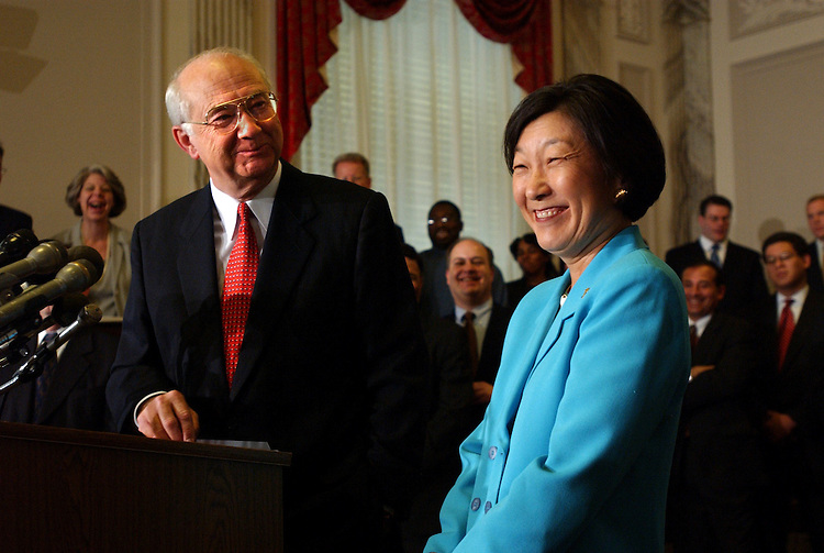 6gramm090401 -- Sen. Phil Gramm, R-Texas, alongside his wife Wendy Lee Gramm, announces that he will retire when his term in the Senate is up in 15 months, Tuesday in Russell Building.