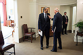 United States President Barack Obama talks with Vice President Joe Biden in the hallway outside of the Oval Office following a meeting, November 26, 2012. .Mandatory Credit: Pete Souza - White House via CNP