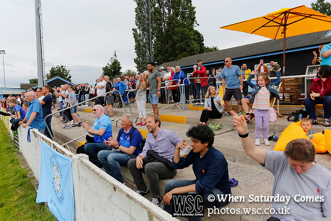 Yorkshire fans celebrating the 93rd minute goal scored by Brodie Litchfield, (not pictured). Yorkshire v Parishes of Jersey, CONIFA Heritage Cup, Ingfield Stadium, Ossett. Yorkshire's first competitive game. The Yorkshire International Football Association was formed in 2017 and accepted by CONIFA in 2018. Their first competative fixture saw them host Parishes of Jersey in the Heritage Cup at Ingfield stadium in Ossett. Yorkshire won 1-0 with a 93 minute goal in front of 521 people. Photo by Paul Thompson