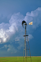 Windmill on Great Plains with severe thunderstorm in background, near of Meade, Kansas, AGPix_0062.