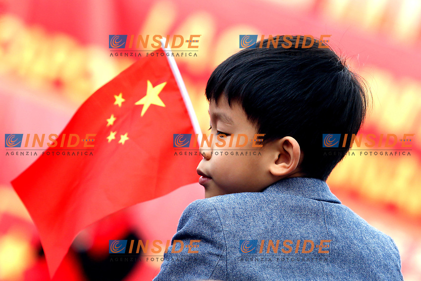 A child with a Chinese flag<br /> Rome February 10th 2019. Celebrations for Chinese New Year 2019 in Rome. This year begins the year of the pig.<br /> Foto Samantha Zucchi Insidefoto