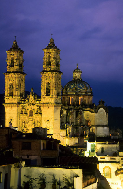 """Santa Prisca church.Taxco de Alarcón (usually referred to as simply """"Taxco"""") is a small city and municipality located in the Mexican state of Guerrero. The name Taxco is most likely derived from the Nahuatl word tlacheco, which means """"place of the ballgame."""" However, one interpretation has the name coming from the word tatzco which means """"where the father of the water is,"""" due to the high waterfall near the town center on Atatzin Mountain. """"De Alarcón"""" is in honor of writer Juan Ruiz de Alarcón who was a native of the town. Like many municipalities in central Mexico, the municipality's coat-of-arms is an Aztec glyph. This glyph is in the shape of a Mesoamerican ballcourt with rings, players and skulls, derived from the most likely source of Taxco's name.[1].The city is heavily associated with silver, both with the mining of it and other metals and for the crafting of it into jewelry, silverware and other items. This reputation, along with the city's picturesque homes and surrounding landscapes have made tourism the main economic activity as the only large-scale mining operation here is coming to a close.[2][3].Taxco is located in the north-central part of the state, 36 km from the city of Iguala, 135 km from the state capital of Chilpancingo and 170 km southwest of Mexico City. The city was named one of Mexico's """"Pueblos Mágicos"""" (Magical Towns) due to the quality of the silverwork, the colonial constructions and the surrounding scenery.[2][4]"""