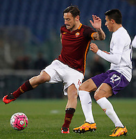 Calcio, Serie A: Roma vs Fiorentina. Roma, stadio Olimpico, 4 marzo 2016.<br /> Roma&rsquo;s Francesco Totti, left, is challenged by Fiorentina&rsquo;s Cristian Tello during the Italian Serie A football match between Roma and Fiorentina at Rome's Olympic stadium, 4 March 2016.<br /> UPDATE IMAGES PRESS/Riccardo De Luca