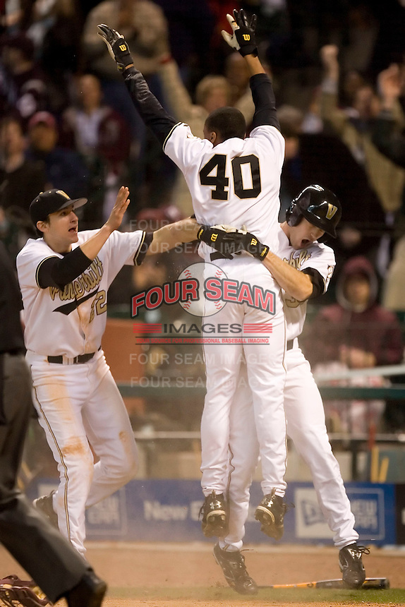 Vanderbilt pinch runner Jonathan White (40) celebrates with teammates after scoring the winning run on a wild pitch in the bottom of the 10th inning versus Arizona State at the 2007 Houston College Classic at Minute Maid Park in Houston, TX, Saturday, February 10, 2007.  The Commodores defeated the Sun Devils 7-6 in 10 innings.