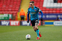 Ashley Hunter of Fleetwood Town dribbles during the Sky Bet League 1 match between Charlton Athletic and Fleetwood Town at The Valley, London, England on 17 March 2018. Photo by Carlton Myrie.