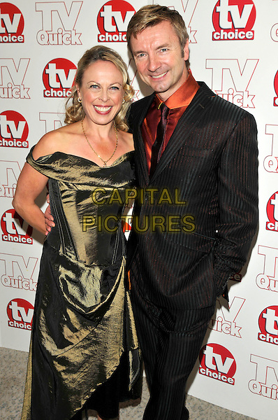 JAYNE TORVILLE & CHRISTOPHER DEAN.attending the TV Quick & TV Choice Awards held at The Dorchester hotel,  in London, England, September 7th 2009..arrivals half length green olive silk dress off the shoulders red shirt tie black pinstripe suit .CAP/PL.©Phil Loftus/Capital Pictures