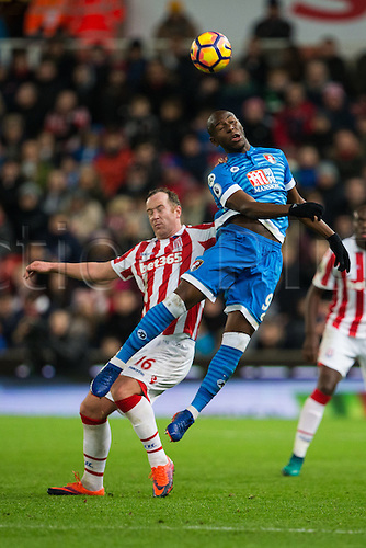 19.11.2016. Bet365 Stadium, Stoke, England. Premier League Football. Stoke City versus AFC Bournemouth. Bournemouth forward Benik Afobe beats Stoke City midfielder Charlie Adam to the ball.