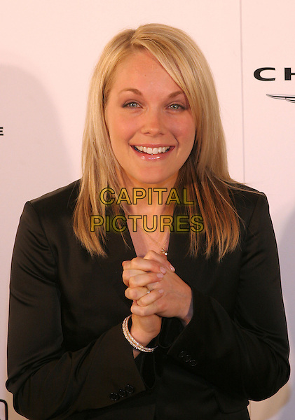 ANDREA ANDERS.8th Annual Lili Claire Foundation Benefit held at the Beverly Hilton Hotel, Beverly Hills, California.  .October 15th, 2005.Photo Credit: Zach Lipp/AdMedia/Capital Pictures.Ref: Zl/ADM/CAP.half length hands clasped.www.capitalpictures.com.sales@capitalpictures.com.© Capital Pictures.