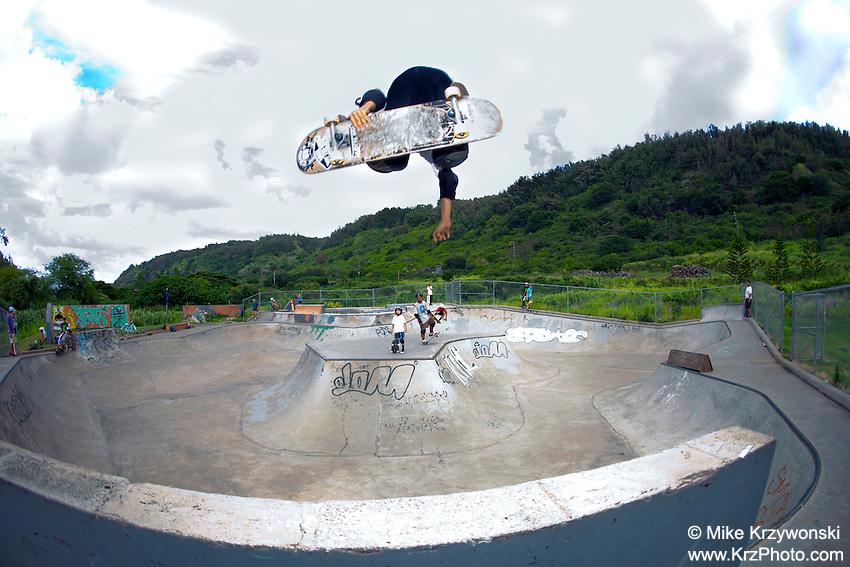 Young boy getting air on a skateboard at the Banzai Skate Park, North Shore, Oahu, Hawaii