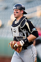 Kevin Plawecki (26) of the Purdue Boilermakers walks out to home plate in the bottom of the first inning during a game against the Missouri State Bears at Hammons Field on March 13, 2012 in Springfield, Missouri. (David Welker / Four Seam Images)