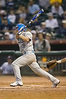 Blair Dunlap #9 of the UCLA Bruins follows through on his swing versus the Rice Owls in the 2009 Houston College Classic at Minute Maid Park February 27, 2009 in Houston, TX.  The Owls defeated the Bruins 5-4 in 10 innings. (Photo by Brian Westerholt / Four Seam Images)