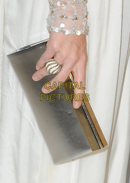 Molly Sims' bag.The 21st Annual Elton John AIDS Foundation Academy Awards Viewing Party held at The City of West Hollywood Park in West Hollywood, California, USA..February 24th, 2013.oscars hand detail silver clutch ring white  .CAP/DVS.©DVS/Capital Pictures.