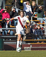 Virginia Tech forward David Clemens (11) brings the ball forward. Boston College (maroon) defeated Virginia Tech (Virginia Polytechnic Institute and State University) (white), 3-1, at Newton Campus Field, on November 3, 2013.