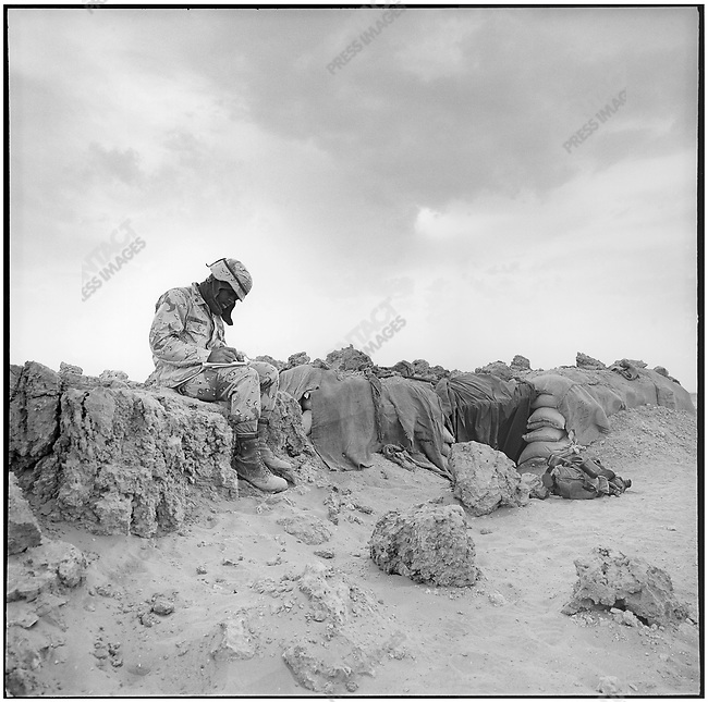 US soldier writing a letter, Saudi Arabia, 1991