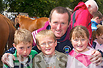 The OConnor family from Dromid admiring the horses at Kenmare Fair on Wednesday. L-r: Shane, Niall, Denis and Grace..