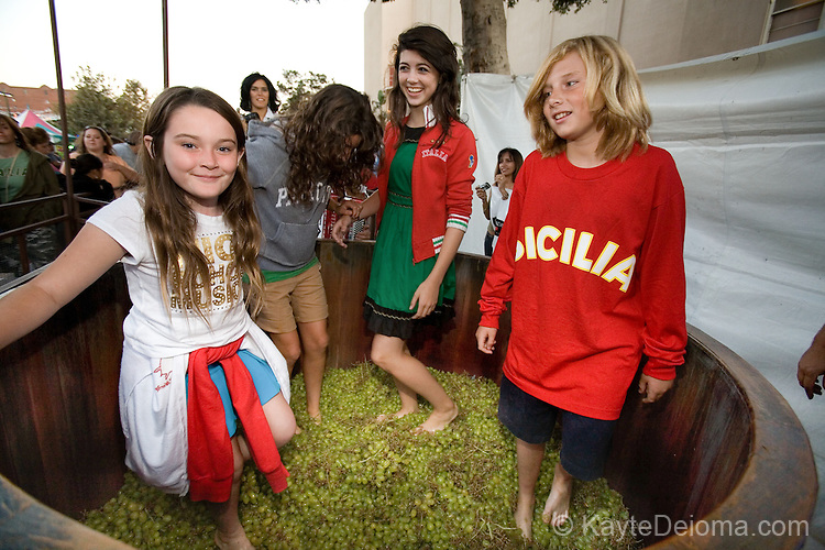 Kids try their feet at grape stomping at the Italian Feast of San Gennaro - Los Angeles, CA
