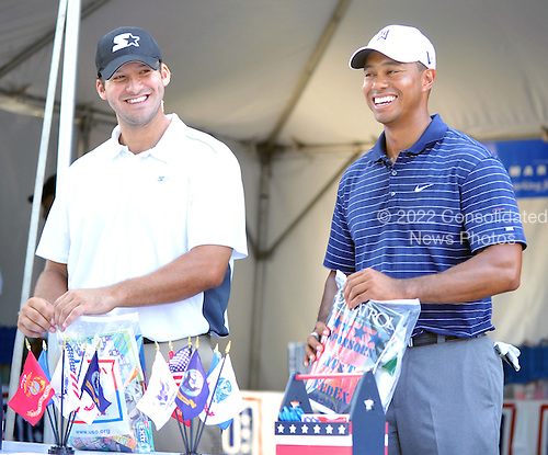 Bethesda, MD - July 1, 2009 -- Tiger Woods, right, and Dallas Cowboys quarterback Tony Romo, left, fill gift bags for United States Troops overseas at the USO tent during the Earl Woods Memorial Pro-Am prior  to the AT&T National Hosted by Tiger Woods at Congressional Country Club in Bethesda, Maryland on Wednesday, July 1, 2009..Credit: Ron Sachs / CNP