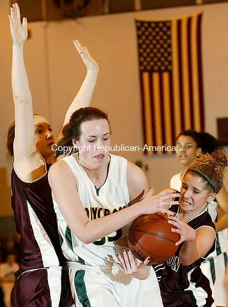 WATERBURY, CT 02/20/08- 022008BZ09- Holy Cross' Tara Stevenson (33) under pressure from Torrington's Lindsey Begey (32) and Amy Rice (21) during the NVL Basketball Championship at Kennedy High School Wednesday night. <br /> Jamison C. Bazinet Republican-American