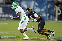 1 September 2011:  FIU's Chuck Grace (21) chases down North Texas' Lance Dunbar (5) in the first half as the FIU Golden Panthers defeated the University of North Texas, 41-16, at University Park Stadium in Miami, Florida.