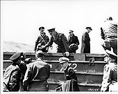 "Vierville Sur Mer, France - June 12, 1944 -- General Dwight D. Eisenhower, United States Army embarks from a ""Duck"" on the Vierville Sur Mer, France on 12 June, 1944.  Admiral Ernest J. King, United States Navy, and General George C. Marshall, United States Army are in foreground..Credit: U.S. Army photo / CNP"