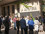 Groups of tourists wait in line at the entrance to the Alhambra, Granada, Spain