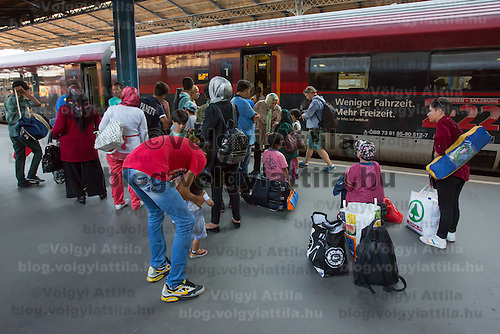Illegal migrant family waits try to board a train to travel to Germany at the main railway station Keleti in Budapest, Hungary on August 31, 2015. ATTILA VOLGYI