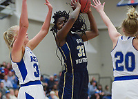 NWA Democrat-Gazette/CHARLIE KAIJO Bentonville West High School forward Jada Curtis (32) takes a shot during a basketball game, Friday, February 8, 2019 at Rogers High School in Rogers.