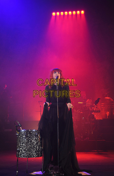 FLORENCE WELCH.Florence And The Machine performing at Hammersmith Apollo, London, England..13th May 2010.stage concert live gig performance music full length black dress singing sheer.CAP/BEL.©Tom Belcher/Capital Pictures.