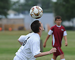 A Lafreniere Soccer player heads the ball during a soccer match.