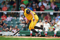 Jacksonville Suns outfielder Carlos Lopez (7) lays down a bunt during the 20th Annual Rickwood Classic Game against the Birmingham Barons on May 27, 2015 at Rickwood Field in Birmingham, Alabama.  Jacksonville defeated Birmingham by the score of 8-2 at the countries oldest ballpark, Rickwood opened in 1910 and has been most notably the home of the Birmingham Barons of the Southern League and Birmingham Black Barons of the Negro League.  (Mike Janes/Four Seam Images)