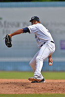 Asheville Tourists pitcher Carlos Estevez #35 delivers a pitch during a game against the Greenville Drive at McCormick Field on May 18, 2014 in Asheville, North Carolina. The Tourists defeated the Drive 3-1. (Tony Farlow/Four Seam Images)