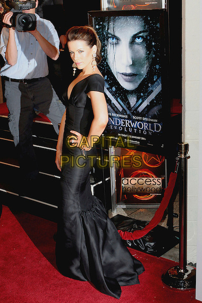 "KATE BECKINSALE.World Premiere of ""Underworld Evolution"" held at the Cinerama Dome, Hollywood, California..January 11th, 2006.Photo: Zach Lipp/AdMedia/Capital Pictures.Ref: ZL/ADM.full length black dress hand on hip.www.capitalpictures.com.sales@capitalpictures.com.© Capital Pictures."