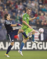 Seattle Sounders forward Nate Jaqua (21) heads the ball. In a Major League Soccer (MLS) match, the Seattle Sounders FC defeated the New England Revolution, 2-1, at Gillette Stadium on October 1, 2011.