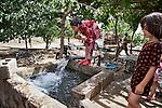05/06/14. Goktapa, Iraq. Shokan, Mr. Abdullah's grand daughter, washing her face after a long working day