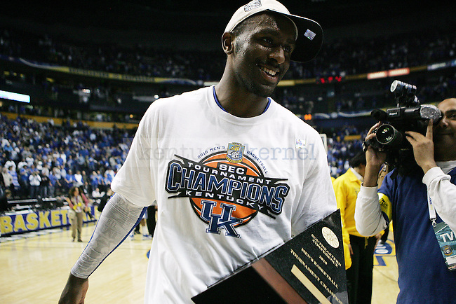 Junior Patrick Patterson walks off the court with the championship trophy after UK's win 75-74 over Mississippi State  Bridgestone Arena in the SEC Finals on Sunday, March 14, 2010. Photo by Britney McIntosh | Staff