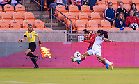 HOUSTON, TX - JANUARY 28: Jazmin Elizondo #19 of Costa Rica crosses the ball in front of Maryorie Perez #14 of Panama during a game between Costa Rica and Panama at BBVA Stadium on January 28, 2020 in Houston, Texas.