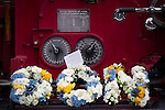 © Joel Goodman - 07973 332324 . 02/09/2013 . Bury , UK . Flowers and tributes placed on the vintage fire engine that carried the coffin to the church . The funeral of fireman Stephen Hunt at Bury Parish Church today (Tuesday 3rd September 2013) . Stephen Hunt died whilst tackling a blaze at Paul's Hair World in Manchester City Centre in July 2013 . Photo credit : Joel Goodman